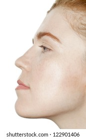 Side view of female face against white background