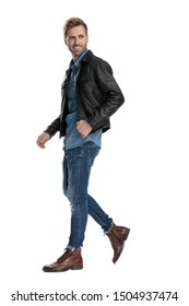 side view of a fine casual man with black leather jacket walking and looking over shoulder happy on white studio background