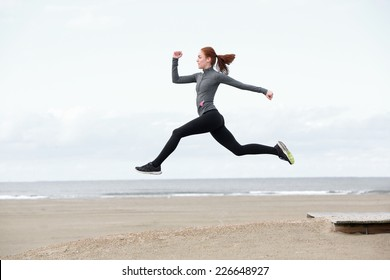 Side view fit young woman running and jumping outdoors