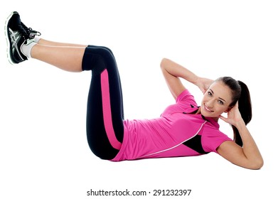 Side view of a fit young woman doing crunches
