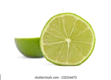 Side view of a fresh sliced organic lime on white background.