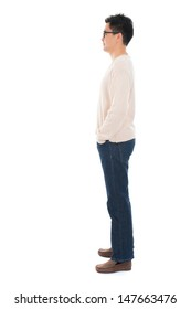 Side view full body casual Asian man standing isolated on white background