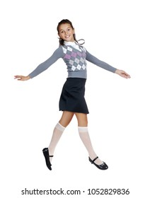 Side view full length picture of a jumping schoolgirl