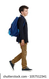 Side view full length picture of a walking schoolboy
