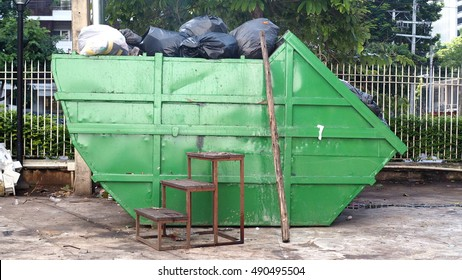 Side view of garbage skid container