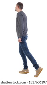 Side view of going  handsome man. walking young guy . Rear view people collection.  backside view of person.  Isolated over white background. The guy in the gray sweater is on his toes