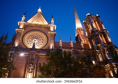 Side view of gothic church called Iglesia del Sagrado Corazon de Jesus also known as Iglesia de los Capuchinos located in Cordoba, Argentina. Catholic church illuminated with backlight at night time