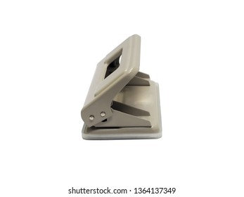 side view of gray paper hole puncher of office stationery isolated on white background