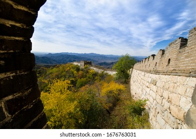 A side view of the Great Wall of China trailing endlessly through the landscapes.