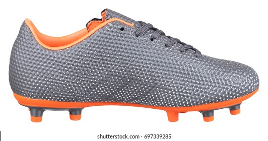 Side view of grey and orange football boot with spikes, honeycombs texture and shoelaces, isolated on white