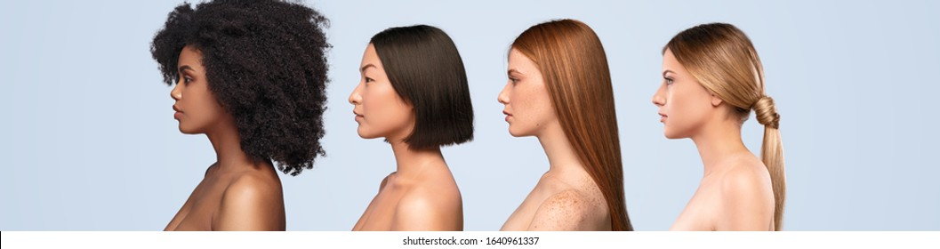 Side view of group of young diverse women with perfect skin standing against blue background and representing spa industry