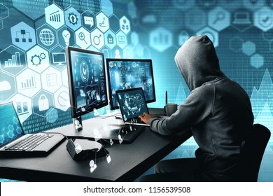 Side view of hacker using computer with digital interface while sitting at desk of blurry interior. Hacking and thief concept.