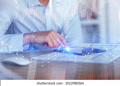 Side view of hand using tablet at desk with architectural sketch and forex chart. Analysis and fund management concept. Double exposure