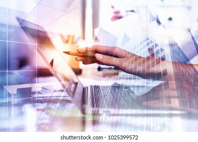 Side view of hands using laptop on abstract city background. Network and technology concept. Double exposure