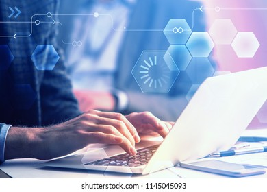 Side view of hands using laptop with diigtal business interface. Future and technology concept. Double exposure