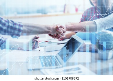 Side view of handshake on abstract forex workplace background. Teamwork and statistics concept. Double exposure
