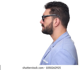 Side view of handsome bearded man in casual clothes, and spectacles on white background