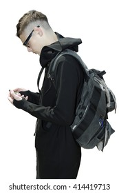 side view of a handsome man in robes and black glasse swith a backpack  texting on a smart phone isolated on a white background