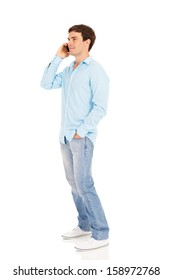 side view of handsome man talking on cell phone on white background
