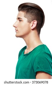 Side view of a handsome young man facial portrait isolated on a white background