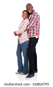 side view of happy young black couple hugging