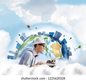 Side view of hard-working man writer using typing machine while sitting at the table with panoramic Earth view and cloudy skyscape on background. Elements of this image furnished by NASA