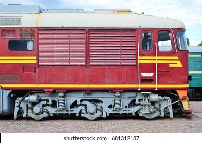 Side view of the head of railway train with a lot of wheels and windows in the form of portholes