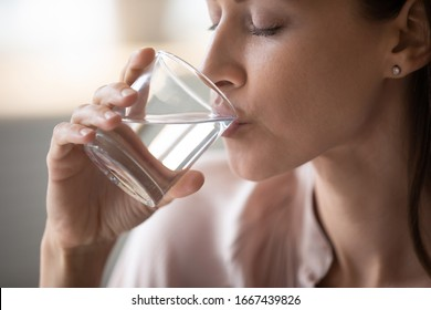 Side view head shot close up young woman drinking pure still water in morning. Healthy thirsty lady enjoying healthy lifestyle daily habit, natural beauty, perfect skin body care aqua balance concept. - Shutterstock ID 1667439826