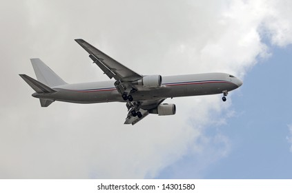 Side view of heavy cargo jet approaching for landing