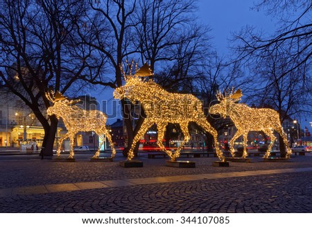 side view of a herd of christmas moose made of led light nybrokajen stockholm