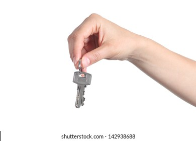 Side view of home keys hanging from a woman hand isolated on a white background