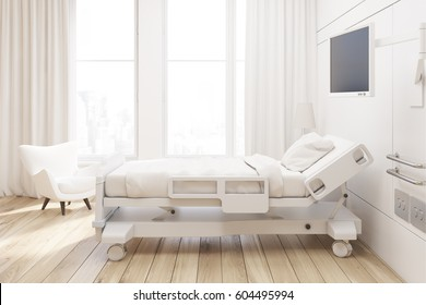 Side view of a hospital ward with a bed, a tv set, a white armchair and curtains on large windows. 3d rendering, Mock up