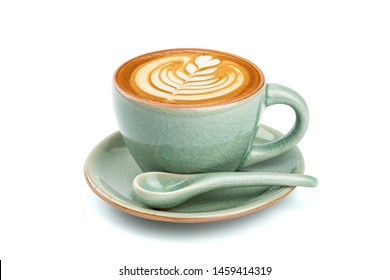 Side view of hot latte coffee with latte art in a ceramic green cup and saucer isolated on white background with clipping path inside. Image stacking techniques.