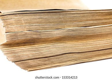 Side View Of Huge Stack of Recycled Paper cardstocks  isolated on white background, close up. Business concept.
