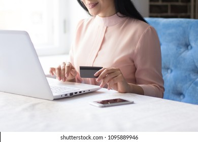Side view image of confident businesswoman working on laptop. Business concept.