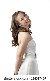 Side view image of a lovely lady on prom dress smiling on a white surface