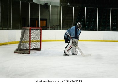A side view of just the goalie during a hockey practice.