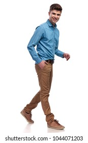 side view of a laughing casual man walking on white background