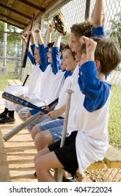 Side view little league baseball team cheering