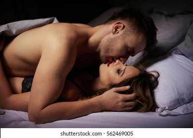 Side view of loving couple in the night light