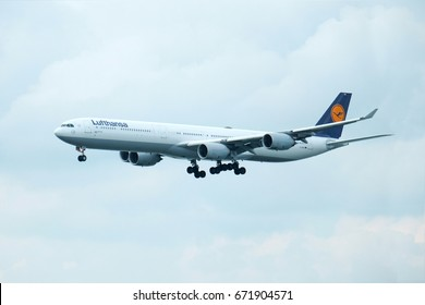Side view of Lufthansa German airplane flying in the sky landing to Hong kong, shooting from Hongkong national airport 2017