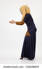 Side view malay woman with tudung greeting