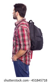 Side view of a male student holding a backpack, isolated on white background
