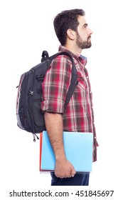 Side view of a male student standing with backpack and notebooks, isolated on white background