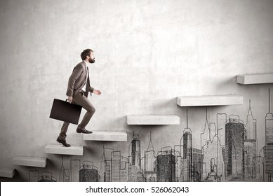 Side view of a man climbing the stairs built in a concrete wall. There is a city sketch under it. Concept of success and achieving your goal. Mock up