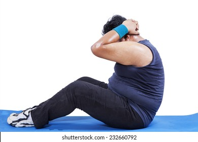 Side view of man doing workout to lose weight in studio, isolated over white
