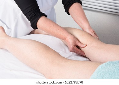 Side view of a man legs receiving a massage therapy