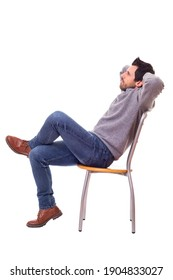 Side view of a man sitting on a chair. Isolated over white background.