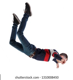 Side view of man in zero gravity or a fall. guy is flying, falling or floating in the air. Side view people collection.   Isolated over white background. A man in a striped sweater in free fall.