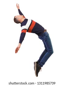 Side view of man in zero gravity or a fall. guy is flying, falling or floating in the air.   side view of person.  Isolated over white background. Dancer in jeans balancing on the toes.